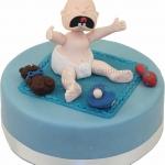 Baby Scheiend Auf Blauer Torte WEB